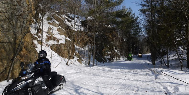 Snowmobilers on Cat Trails, winter